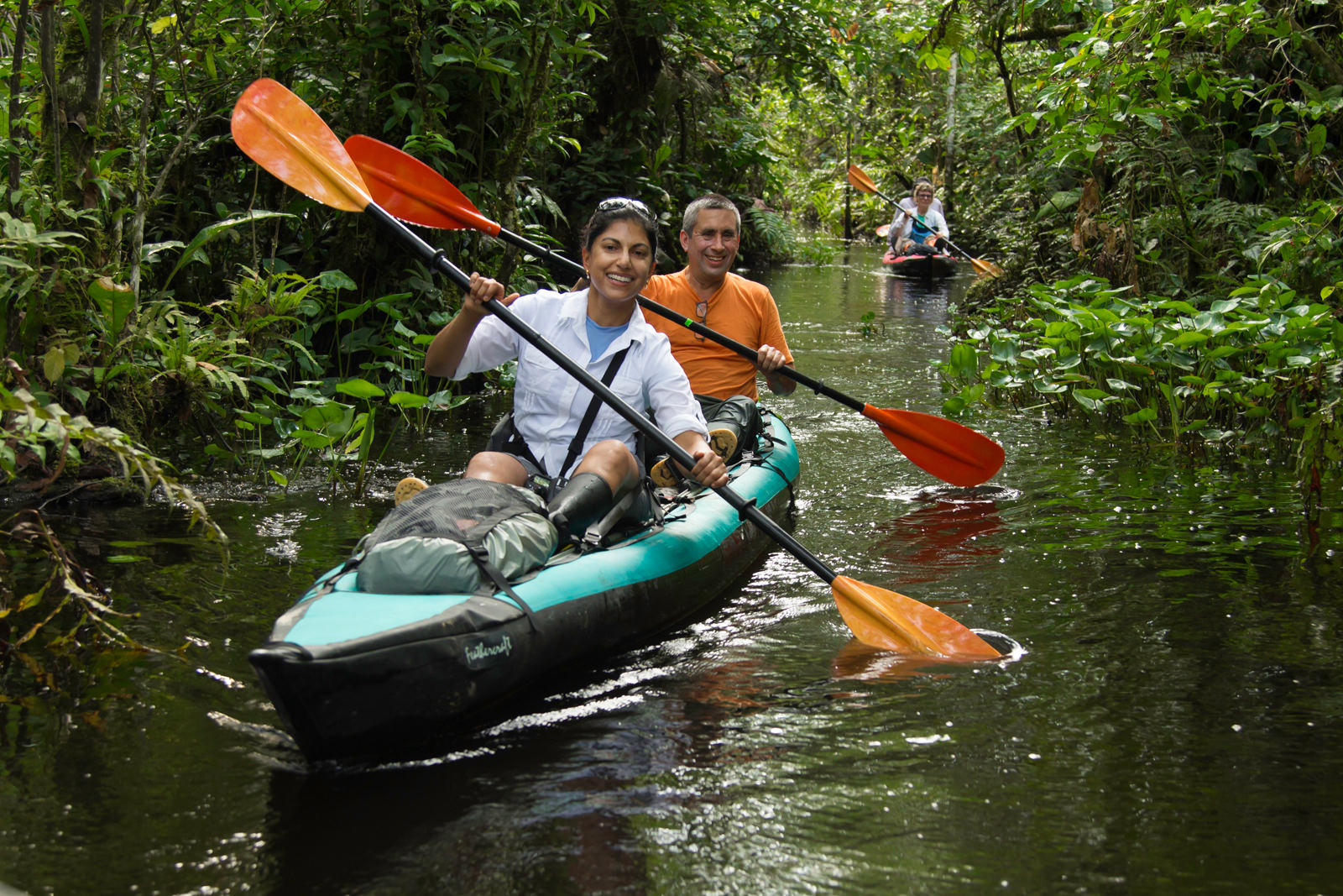 Amazon kayaking trip participants exploring tributary stream