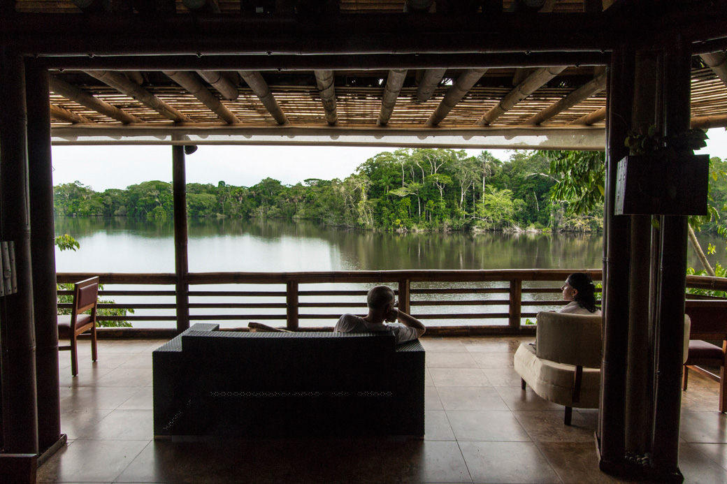 Kayakers relaxing on the deck of La Selva Lodge at the end of a day paddling Amazon rivers
