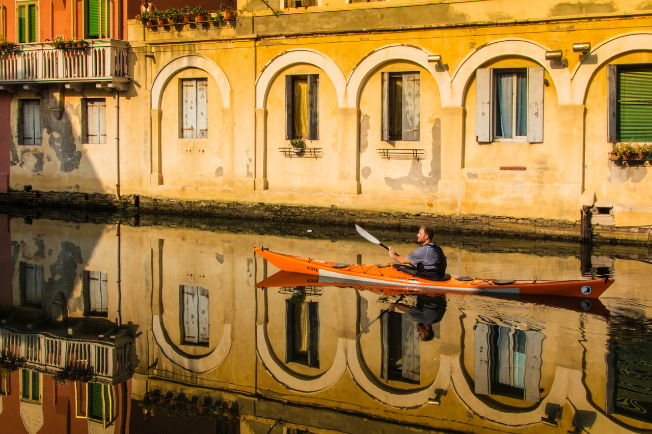 Kayaker in the Chioggia Canals of the Venice Laguna