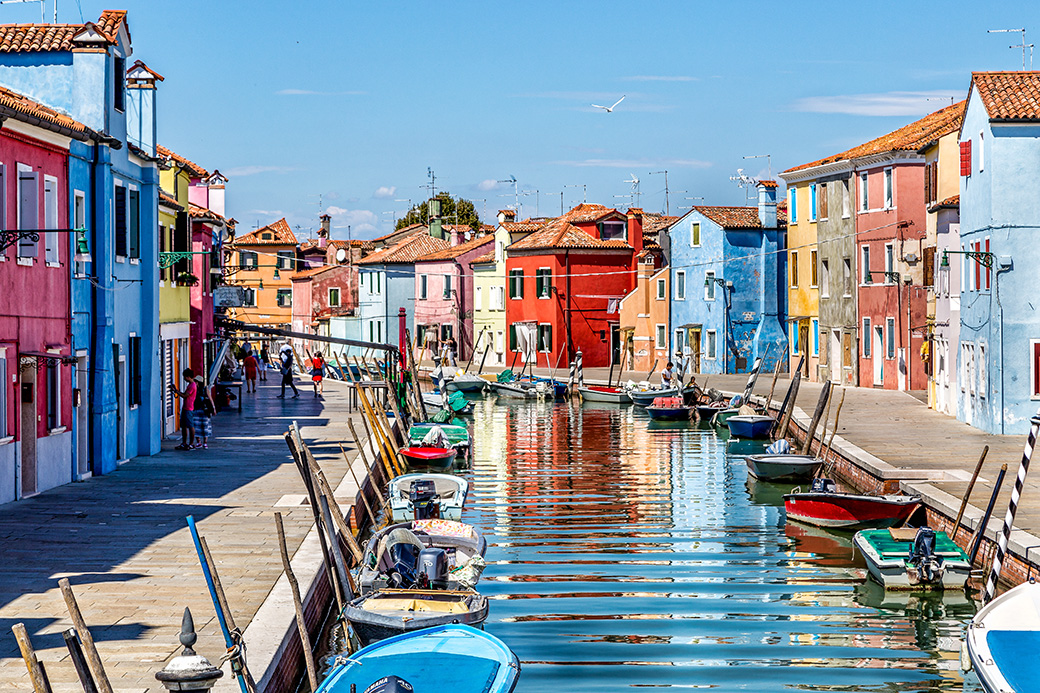 Canal reflections in colorful Burano island near Venice