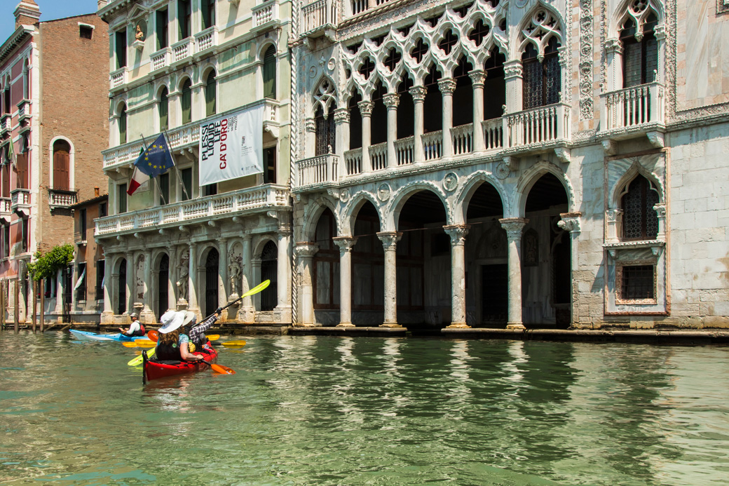 Padders Observe Architectural Detail Along the Canal Grande, Venice