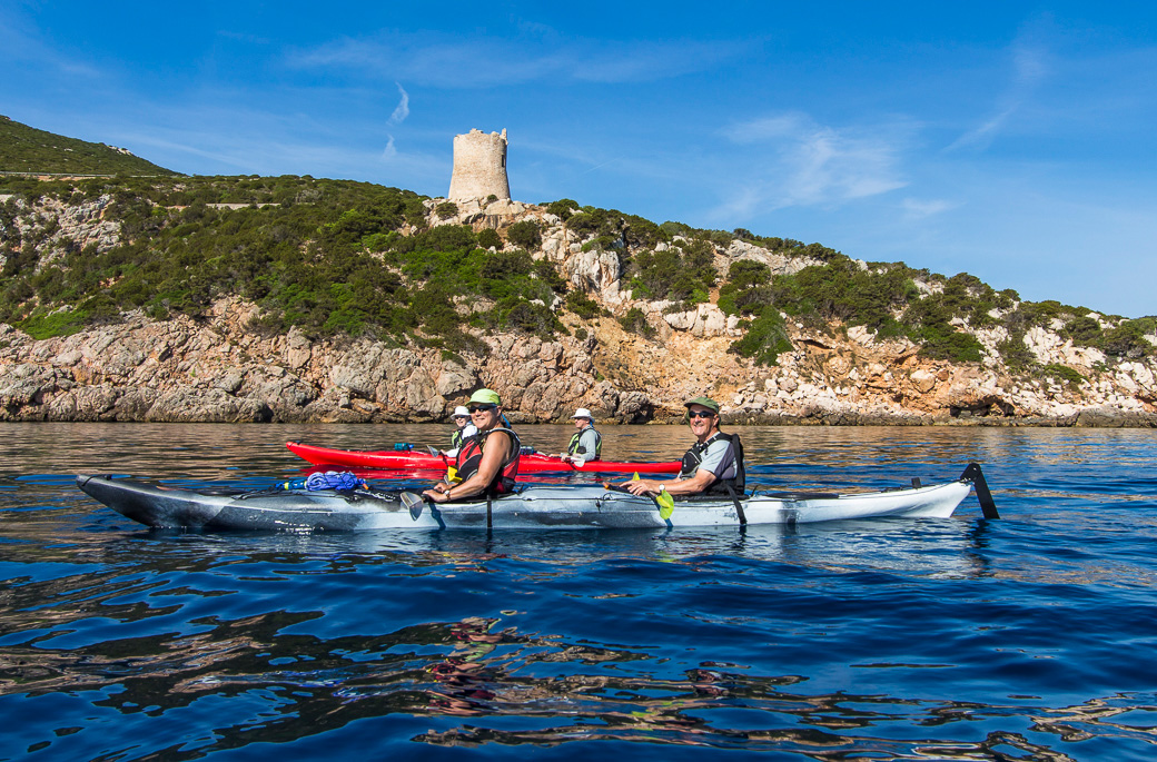 Paddling past an ancient Genovese tower on the way to Capa Caccia near Alghero