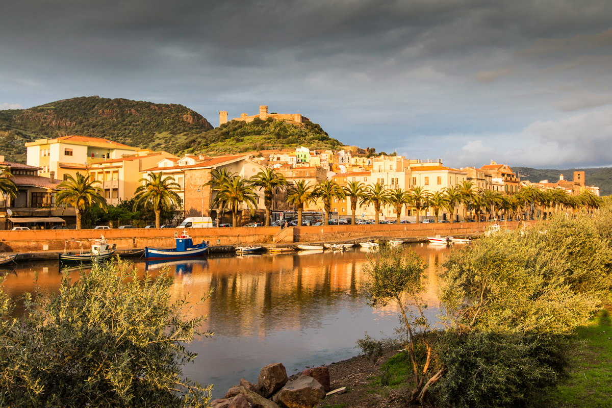 Sunset light on the town of Bosa and Malaspina Castle, kayaking Sardinia